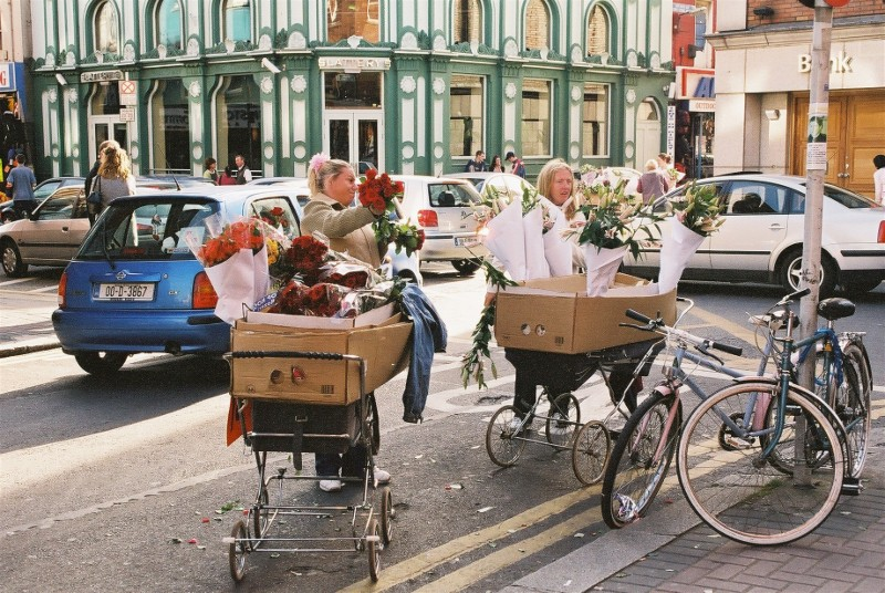 Flowers for sales.  As she pushed her wheel-barrow  thro' streets broad and narrow, crying 'Cocles and mussels, a-live     a-live- oh!'